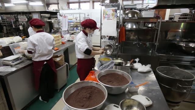 Wide shot Kimuraya employee works at the company's bakery in Rikuzentakata Iwate prefecture Japan on Saturday Jan 17 2015 Wide shot Kimuraya...