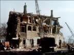 1956 Wide shot large house being demolished