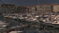Wide Shot Locked Down -  The Old Port of Marseille, marinas full of pleasure-boats, old city in background / Marseille France