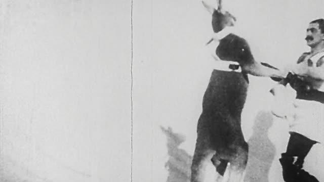 1895 wide shot man and kangaroo performing boxing act in German vaudeville show