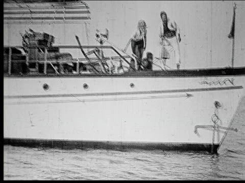 1914 B/W Wide shot Man and woman jumping off steamboat deck into sea and swimming away