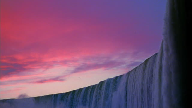 Wide shot Niagara Falls at dusk on Canadian side