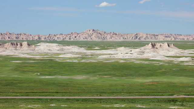 Wide Shot of a prairie and crested buttes in Badlands National Park
