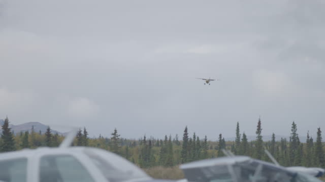 Wide shot of an airplane landing at Iliamna Airport