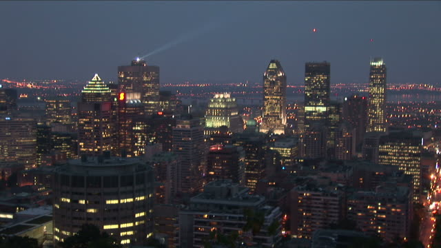 Wide shot of buildings at night in Montreal Canada