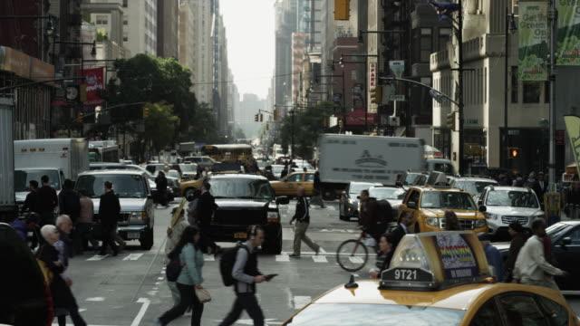 Wide shot of bustling city street / New York City, New York, United States