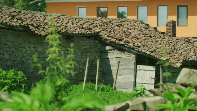 Wide shot of clay tiles on roof / Plakovo, Bulgaria
