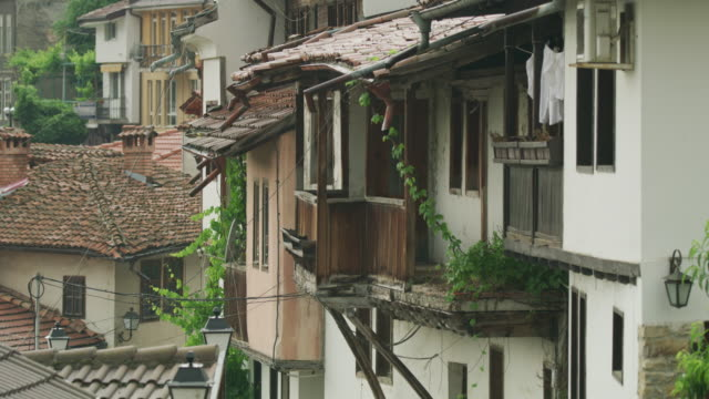 Wide shot of dense city with clay tiles on roofs / Veliko Tarnovo, Bulgaria