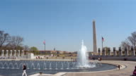 WIde shot of fountain at National War Memorial with view of Washington Monument / Washington, DC
