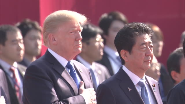 Wide shot of Guest House Prime Minister Abe greeting President Trump and First Lady Trump receiving Honor Guard Abe and Trump reviewing the guards