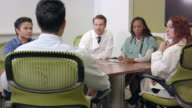 Wide Shot of Medical Professionals in Meeting