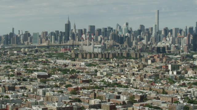 Wide shot of New York cityscape with the Queensboro Bridge and Manhattan buildings in the background