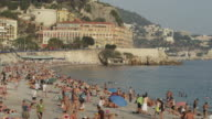 Wide shot of people enjoying French beach / Nice, France