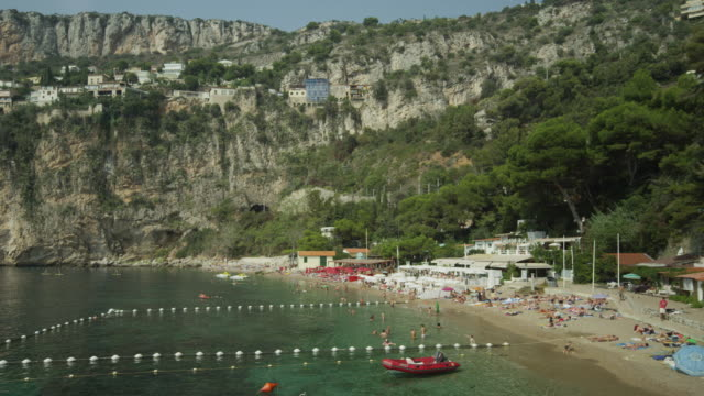 Wide shot of people enjoying the beach / Cap d'Ail, France