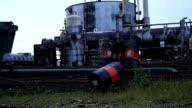 Wide shot of rusty Texaco barrels abandoned in Amazonian dumpster