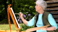 Wide Shot of Senior Woman Painting