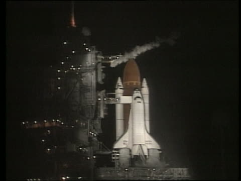 1988 wide shot of Space Shuttle Discovery on launch pad at night
