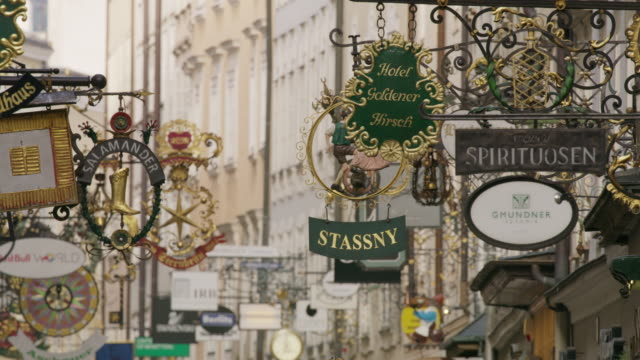 Wide shot of store signs in city / Salzburg, Austria