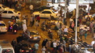 Wide shot of street vendors and traffic