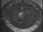 Wide shot of the interior of the Historical Society of Pennsylvania / close up of US Marines insignia / Major General Alexander A Vandergrift sits...