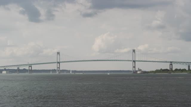 Wide shot of the Newport Bridge over the Harbor in Rhode Island.