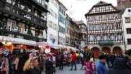 Wide shot of tourists and vendors in Place Kleber- the central square of Strasbourg