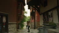 Wide shot of women standing and admiring architecture / Plovdiv, Bulgaria