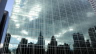 Wide shot Office building reflecting clouds in mirrored glass/ New York City, New York, USA