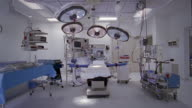Wide shot operating table and equipment in operating theater