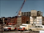 1956 Wide shot pan city block to demolition site with the debris of several buildings that have been knocked down