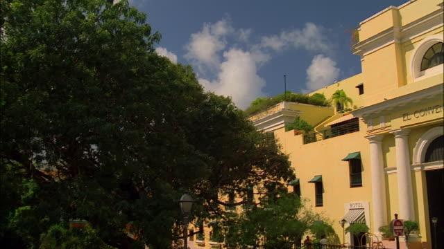 Wide shot pan exterior of hotel and former Carmelite convent El Convento / Old San Juan, Puerto Rico