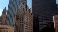 Wide shot pan HSBC Building, Liberty Tower, Federal Reserve Bank, Chase Manhattan Tower and AIG Building/ NYC