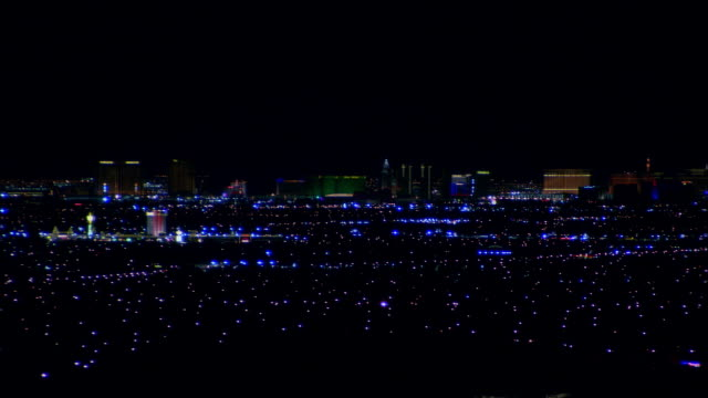 Wide shot pan Lights glowing on cityscape/ Las Vegas, Nevada, USA