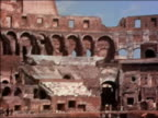 1938 wide shot pan men working inside ruins of Coliseum / Rome, Italy