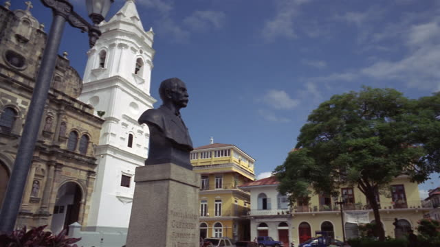 Wide shot pan Metropolitan Cathedral with statue of Manuel Amador Guerrero in foreground/ Panama City, Panama