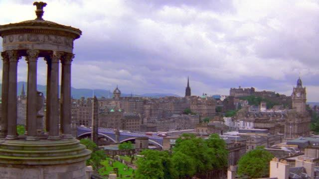 Wide shot pan past Balmoral Hotel to view from Calton Hill / Edinburgh, Scotland