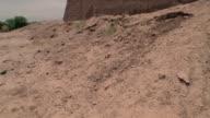 1999 Wide shot pan Ruins of ancient adobe wall remaining in Iranian Desert/ Bam, Kerman Province, Iran