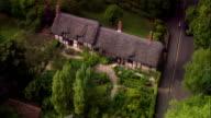 Wide shot pan Tourists sightseeing at Anne Hatherway's cottage/ Shottery, Warwickshire, England