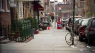 Wide shot pan Woman walking down city street / Williamsburg, Brooklyn, New York, USA