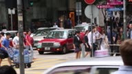 Wide shot pedestrians cross a road in the central business district of Hong Kong China on Thursday July 9 Medium shot pedestrians cross a road in the...