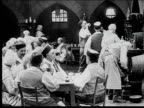 1916 Wide shot people in tavern all getting up and running out at once