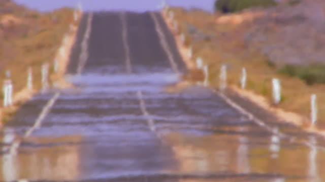 Wide shot rural highway with heatwave distortion
