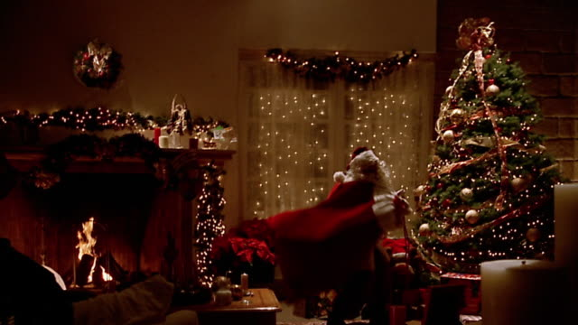wide santa claus entering decorated living room