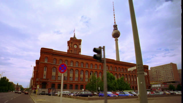 wide shot side car point of view Berlin Town Hall (Berliner Rathaus) with Television Tower in background / Berlin, Germany