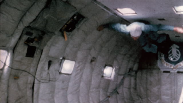 1965 wide shot smiling astronaut floating in weightlessness