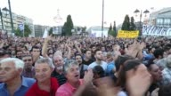 Wide shot supporters of the 'OXI' or 'No' vote gather outside the parliament on Syntagma square as early results show them ahead in the Greek...