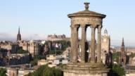 Wide shot the Dugald Stewart Monument viewed from Calton Hill in Edinburgh UK on Wednesday July 31 Pan LR Edinburgh city skyline The clock tower of...