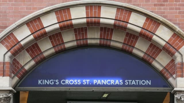 Wide shot the exterior of the renovated St Pancras International train station building in Kings Cross London UK on Thursday June 19 Black taxi cabs...
