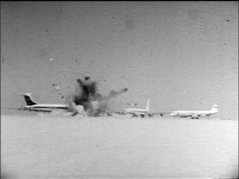 B/W 1970 wide shot three airliners exploding in Jordan desert after being hijacked by PLO terrorists