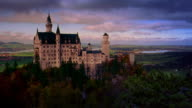 Wide shot time lapse clouds and shadows moving over Neuschwanstein Castle / Bavaria, Germany